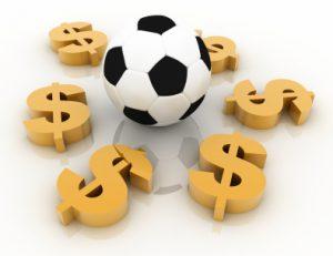 Balón de fútbol rodeado de dólares